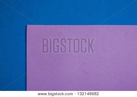 Eva foam ethylene vinyl acetate smooth bright purple surface on blue sponge plush background