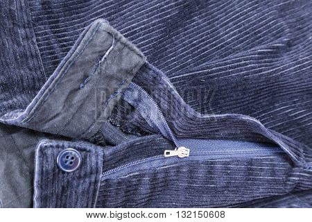 fashion clothing, zipper and button blue corduroy trousers used