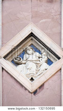 FLORENCE, ITALY - JUNE 05: Saturn by Collaborator of Andrea Pisano, Relief on Giotto Campanile of Cattedrale di Santa Maria del Fiore, Florence, Italy on June 05, 2015