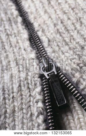 Opened zipper of woolen sweater. Macro shot.