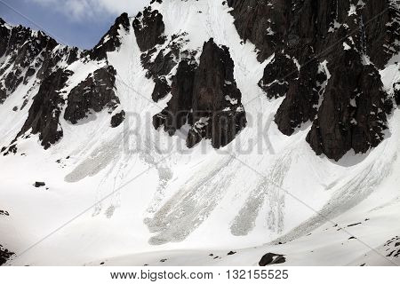 Snowy Rocks With Traces From Avalanche