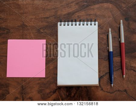 still life of office supplies isolated on wooden background