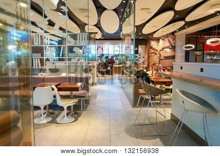 DUBAI, UAE - APRIL 08, 2016: interior of McDonald's restaurant in Dubai International Airport. McDonald's is the world's largest chain of hamburger fast food restaurants