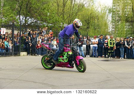Pyatigorsk Russia, 1st May 2015: Moto free style pilot stunting on the square - Pyatigorsk Russia Opening of moto season 2015 on 1st May 2015