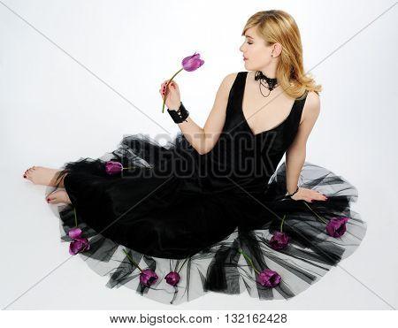 beautiful girl with purple tulip