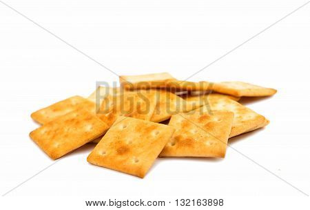 small salty crackers isolated on white background