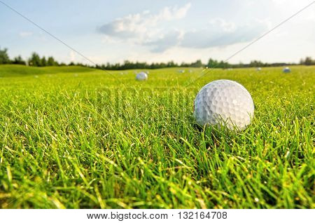 white golf ball on the green field