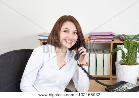 Smiling And Happy Business Woman Talking Phone In Office
