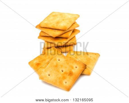small, salty crackers isolated on white background