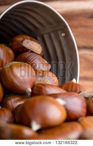pile of chestnuts in a tin bucket overturned