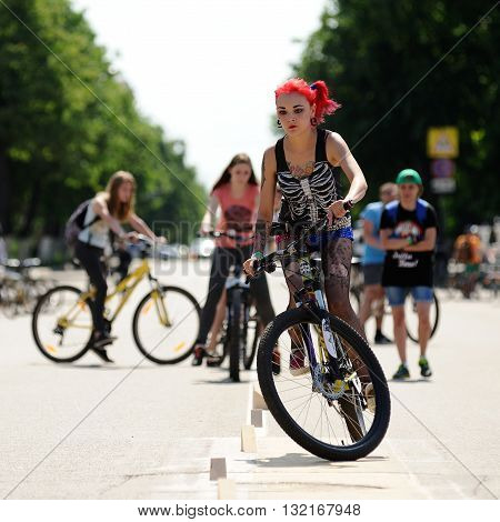 Orel Russia - May 29 2016: Russian Bikeday in Orel. Punk girl overcoming obstacles by bicycle outdoors