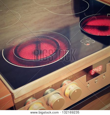 Electric ceramic stove inside the kitchen. Interior cuisine at home..Detail appliances.