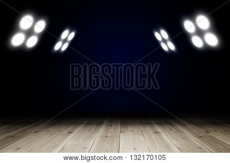 Light in dark room with wooden floor. Copy space for your products