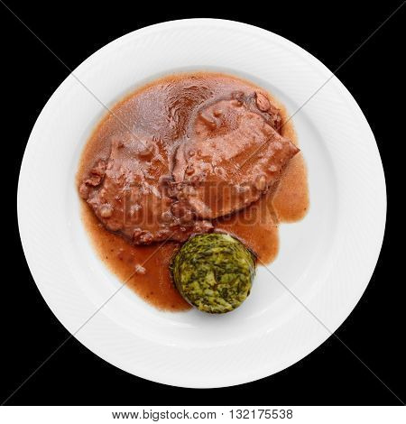 Stewed meat in plate isolated on black background
