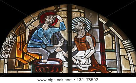 OBERSTAUFEN, GERMANY - OCTOBER 20: Scenes from the life of St. Peter, stained glass window in the parish church of St. Peter and Paul in Oberstaufen, Germany on October 20, 2014.