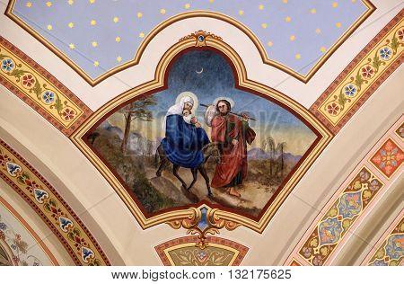 STITAR, CROATIA - AUGUST 27: Flight to Egypt, fresco in the church of Saint Matthew in Stitar, Croatia on August 27, 2015
