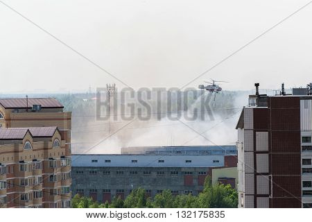 Zelenograd, Russia - May 31.2016. Extinguishing the fire by a helicopter