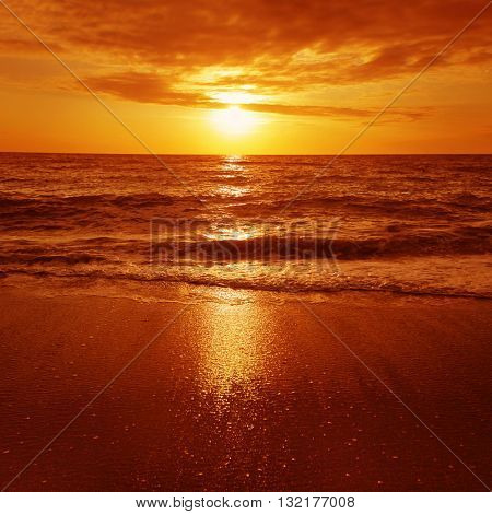 Dramatic red sunset over the sea.