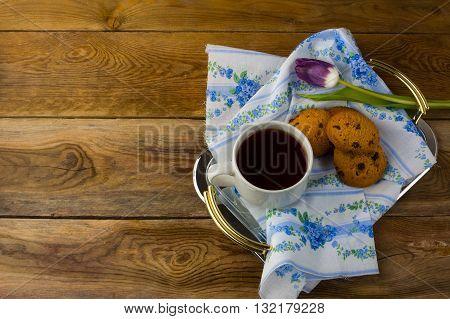 Breakfast tea in serving tray on wooden background. Homemade biscuit. Homemade cookies.Sweet dessert. Breakfast cookies. Sweet pastry. Cup of tea. Tea cup. Breakfast tea.