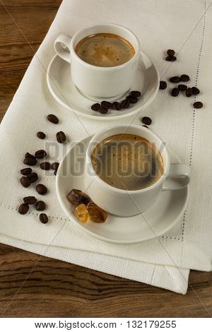 Coffee break on white linen napkin. Coffee cup. Cup of coffee. Strong coffee. Morning coffee. Coffee break. Coffee mug.