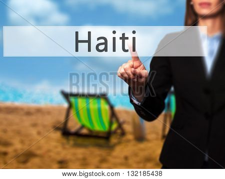 Haiti - Businesswoman Hand Pressing Button On Touch Screen Interface.