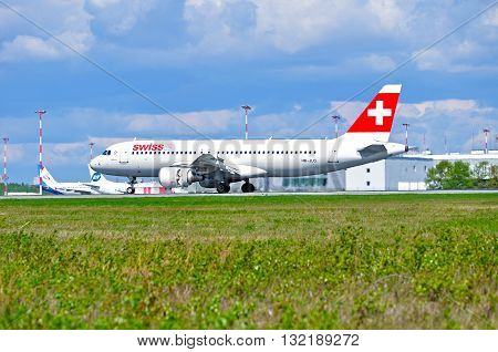 SAINT PETERSBURG RUSSIA - MAY 11 2016. HB-JLQ Swiss International Airlines Airbus A320 airplane rides on the runway after arrival in Pulkovo airport