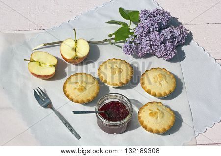 Fresh home made apple pies with fresh apple and raspberry jam