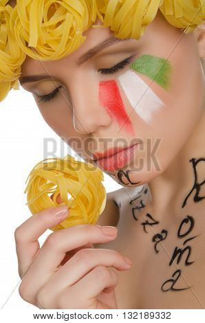 young woman with pasta and symbols of Italy isolated on white