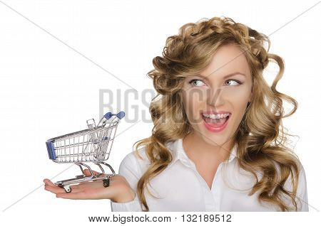 European woman with trolley for shopping isolated on white