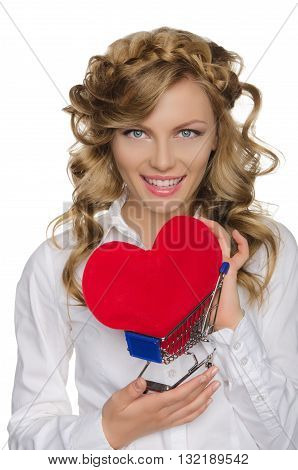 smiling woman with heart in shopping cart isolated on white