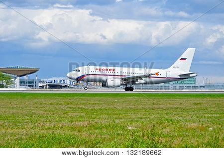 SAINT PETERSBURG RUSSIA - MAY 11 2016. EI-EZD Rossiya Airlines Airbus A319 airplane is riding on the runway after arrival at Pulkovo airport