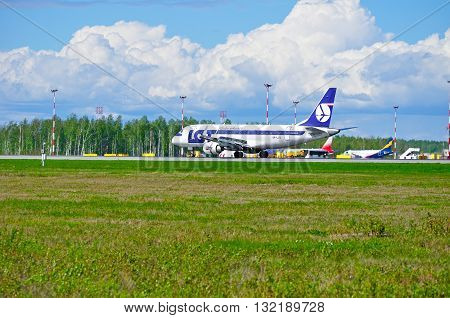 SAINT PETERSBURG RUSSIA - MAY 11 2016. SP-LID LOT Polish Airlines Embraer 175 SD rides on the runway after landing in Pulkovo International airport