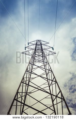 Pylon and transmission power line in cloudy day