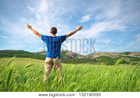 Man in green meadow and sunshine. Conceptual design.