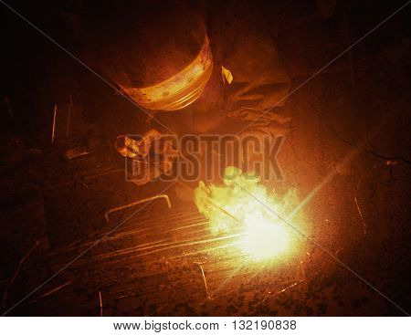 Electric Welder weld metal. Photos in a grunge style.