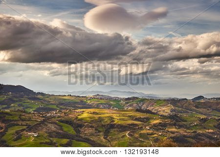 hilly landscape in Italy on a cloudy day
