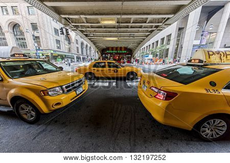 NEW YORK CITY, USA - May 28, 2016: Yellow taxi cabs in New York City wait outside Grand Central Terminal for customers.