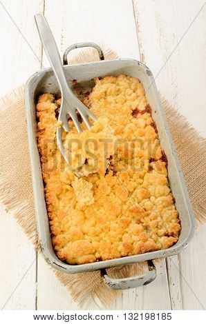 home made sweet cherry crumble in a baking tin