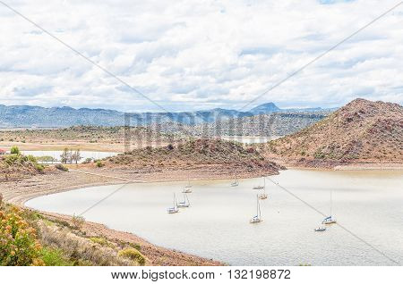 Sail yachts in the Gariep Dam on the border between the Free State and Northern Cape provinces. It is the largest dam in South Africa. The dam is half full