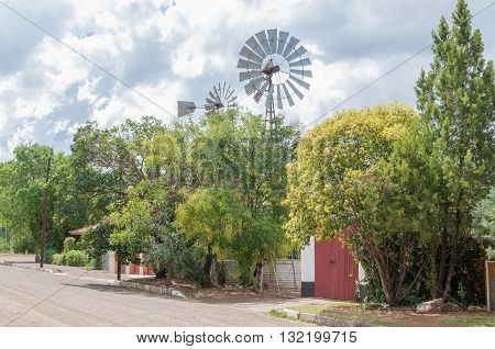 A street scene with water-pumping windmills in Trompsburg a small town in the Free State Province