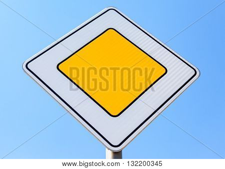Traffic signs main road against the blue sky background