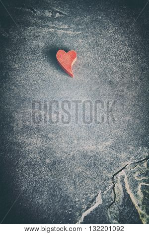 Vintage Toned Heart On Grunge Stone Background.