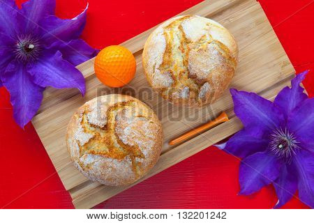 Golf breakfast - Two wheat bread and golf ball on wooden desk