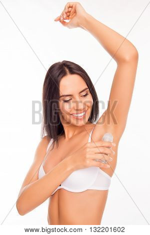 Close Up Photo Of Cheerful Woman Putting Deodorant On Her Armpit