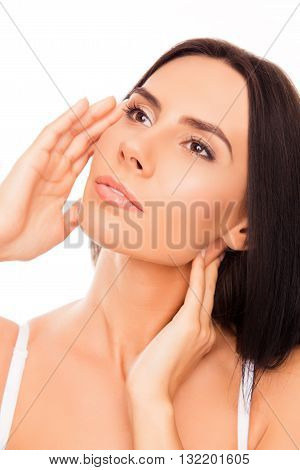 Portrait Of Serious Attractive Girl Touching Her Face
