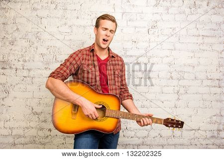 Portrait Of Young Pretty Singer Playing On The Guitar