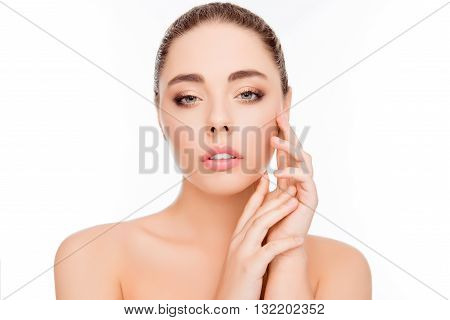 Beautiful healthy woman touching her smooth skin