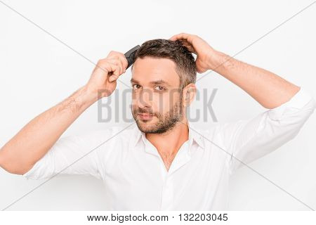 Handsome Cheerful Young Man Combing His Hair With Hairdresser