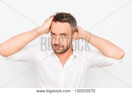 Attractive Man Touching His Hair On White Background