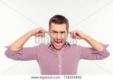 Attractive Man Clossing His Ears And Screaming